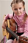 Young girl play classical guitar Stock Photo - Royalty-Free, Artist: jeecis                        , Code: 400-04344925