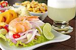 Peruvian ceviche with king prawn accompanied by sweet potatoes, corn, cancha (fried corn) and the Peruvian cocktail called