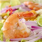 Peruvian Prawn Ceviche: King prawn on red onions and lettuce with lime slices (Selective Focus, Focus on the prawn) Stock Photo - Royalty-Free, Artist: ildi                          , Code: 400-04345425