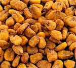 Fried corn snacks closeup on a black background Stock Photo - Royalty-Free, Artist: lindom                        , Code: 400-04348638