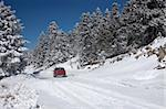 A car in a snow-covered road of mount Parnassos, central Greece Stock Photo - Royalty-Free, Artist: alexandr6868                  , Code: 400-04353501