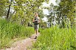 Handsome man in sportswear running in the forest Stock Photo - Royalty-Free, Artist: Leaf                          , Code: 400-04353915