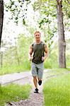 Man jogging during morning time in a park Stock Photo - Royalty-Free, Artist: Leaf                          , Code: 400-04354014