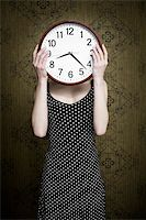 An image of a girl holding a big white clock Stock Photo - Royalty-Freenull, Code: 400-04354041