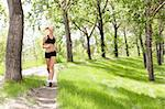 Portrait of a young beautiful smiling woman jogging Stock Photo - Royalty-Free, Artist: Leaf                          , Code: 400-04354426