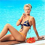 Beautiful woman in bikini near swimming pool Stock Photo - Royalty-Free, Artist: GoodOlga                      , Code: 400-04354614