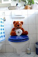 toy teddy bear with paper in the bathroom on toilet Stock Photo - Royalty-Freenull, Code: 400-04355734