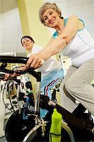 sweaty woman - Portrait of senior females doing physical exercise on special equipment in club Stock Photo - Royalty-Freenull, Code: 400-04356862