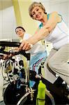 Portrait of senior females doing physical exercise on special equipment in club Stock Photo - Royalty-Free, Artist: pressmaster                   , Code: 400-04356862