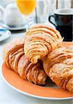 Breakfast with coffee and croissants in a basket on table Stock Photo - Royalty-Free, Artist: ilolab                        , Code: 400-04357759