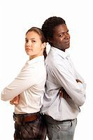 a young team or couple standing with their back to each other looking confident Stock Photo - Royalty-Freenull, Code: 400-04358152