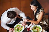 Above view of woman and man eating in cafe Stock Photo - Royalty-Freenull, Code: 400-04358591