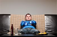 fat man balls - soccer fan is sitting on sofa with beer at home Stock Photo - Royalty-Freenull, Code: 400-04358892