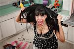 Desperate housewife pulling her hair in a messy kitchen Stock Photo - Royalty-Free, Artist: creatista                     , Code: 400-04358937