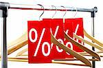 Image of several wooden hangers with red labels showing discount on them Stock Photo - Royalty-Free, Artist: pressmaster                   , Code: 400-04361969