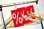 Image of several wooden hangers with red discount tags Stock Photo - Royalty-Free, Artist: pressmaster                   , Code: 400-04361970