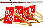 Image of several wooden hangers with red discount tags Stock Photo - Royalty-Free, Artist: pressmaster                   , Code: 400-04361971