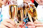 Image of crystal glasses full of champagne held by human hands Stock Photo - Royalty-Free, Artist: pressmaster                   , Code: 400-04362129