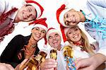 Portrait of smart colleagues with flutes of champagne wishing you Merry Christmas Stock Photo - Royalty-Free, Artist: pressmaster                   , Code: 400-04362132