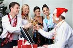Image of cheering associates making toast with ceo in Santa cap at corporate party Stock Photo - Royalty-Free, Artist: pressmaster                   , Code: 400-04362135