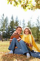 Photo of happy girl with handsome male relaxing outdoors in autumn Stock Photo - Royalty-Freenull, Code: 400-04363569