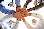 Below shot of four co-workers making pile of hands Stock Photo - Royalty-Free, Artist: pressmaster                   , Code: 400-04363614