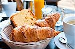 Breakfast with coffee and croissants in a basket on table Stock Photo - Royalty-Free, Artist: ilolab                        , Code: 400-04368470