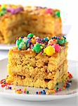 Peruvian colorful cake called Turron flavored with anis, sesame, dried fruits and honey and garnished with colorful sweets on top (Selective Focus, Focus on the front right upper edge of the cake) Stock Photo - Royalty-Free, Artist: ildi                          , Code: 400-04370652