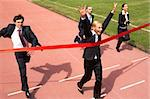 Photo of happy businesswoman crossing finish line during race Stock Photo - Royalty-Free, Artist: pressmaster                   , Code: 400-04372983