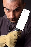 Portrait of scary man with cleaver Stock Photo - Royalty-Freenull, Code: 400-04372990
