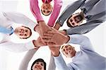 Below shot of smiling co-workers making pile of hands Stock Photo - Royalty-Free, Artist: pressmaster                   , Code: 400-04373651