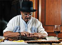 older senior man making luxury handmade cuban cigars Stock Photo - Royalty-Freenull, Code: 400-04377019