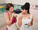 Gossping women smoking and drinking tea in a retro-style kitchen Stock Photo - Royalty-Free, Artist: creatista                     , Code: 400-04380580