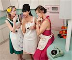 Three beautiful retro-styled women enjoy cup of coffee with cigarette Stock Photo - Royalty-Free, Artist: creatista                     , Code: 400-04380585