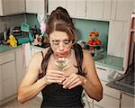 Weeping Caucasian woman drinks a martini in her messy kitchen Stock Photo - Royalty-Free, Artist: creatista                     , Code: 400-04380695