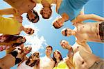 Below view of circle of friends looking at camera with blue sky above them Stock Photo - Royalty-Free, Artist: pressmaster                   , Code: 400-04381038