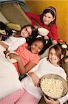 Little girls at a sleepover eat popcorn and tortilla chips Stock Photo - Royalty-Free, Artist: creatista                     , Code: 400-04382076
