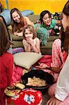 Little girls giggle and eat snacks at a sleepover Stock Photo - Royalty-Free, Artist: creatista                     , Code: 400-04382079