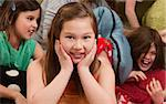Smiling little girl at a sleepover with her friends Stock Photo - Royalty-Free, Artist: creatista                     , Code: 400-04382088