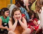 Smiling little girl at a sleepover with her friends Stock Photo - Royalty-Free, Artist: creatista                     , Code: 400-04382090
