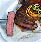 fresh juicy beef rib eye steak grilled with orange and lemon peel on top and vegetable beside Stock Photo - Royalty-Free, Artist: keko64                        , Code: 400-04383203