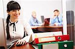 Busy secretary looking at camera in the office Stock Photo - Royalty-Free, Artist: pressmaster                   , Code: 400-04388775