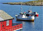 fishing boat in norwegian sea with a red house, Norway Stock Photo - Royalty-Free, Artist: Rigamondis                    , Code: 400-04389691