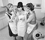 Three retro-styled women smoking cigarettes in a kitchen Stock Photo - Royalty-Free, Artist: creatista                     , Code: 400-04391465