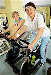 Portrait of senior females doing physical exercise on special equipment in club Stock Photo - Royalty-Free, Artist: pressmaster                   , Code: 400-04391711