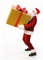 Photo of strong Santa Claus holding heavy gift box over white background Stock Photo - Royalty-Freenull, Code: 400-04392574
