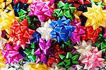 Large heap of colorful decorative bows