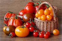 Organic multicolored tomatoes  on a garden wooden table. Stock Photo - Royalty-Freenull, Code: 400-04393898