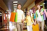 Image of family spending their time in the mall Stock Photo - Royalty-Free, Artist: pressmaster                   , Code: 400-04395476