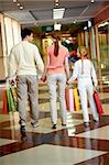 Image of family going to leave the mall after shopping Stock Photo - Royalty-Free, Artist: pressmaster                   , Code: 400-04395480